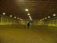 Nearly a full shot of our indoor.  That is a Drum Horse gelding of ours, Zeus being worked.